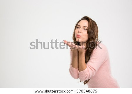 Beautiful woman blowing kiss isolated on a white background - stock photo