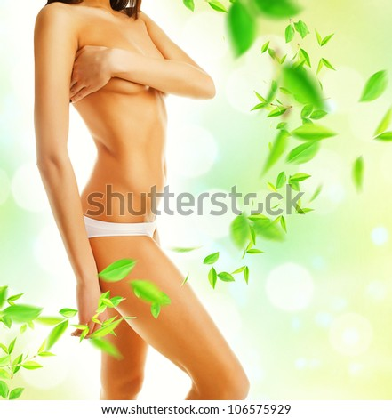 Beautiful woman body and leaves - stock photo