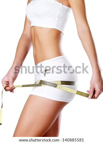 Beautiful woman body with measuring tape. - stock photo