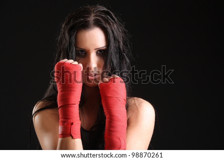 beautiful woman. boxer portrait. bandage on hands - stock photo
