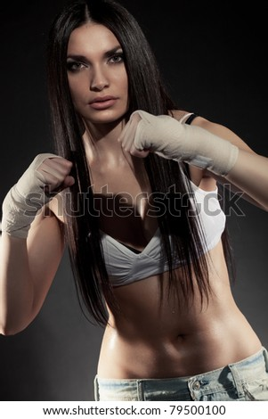 beautiful woman boxer portrait wearing bandage on hands