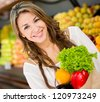 Beautiful woman buying groceries at the supermarket - stock photo