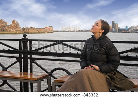 beautiful woman by the river thames