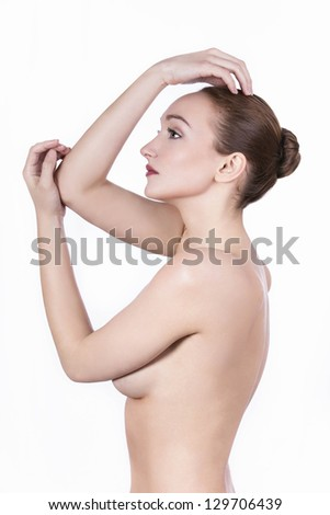 Beautiful woman cares for the  beauty of the body, posing in studio
