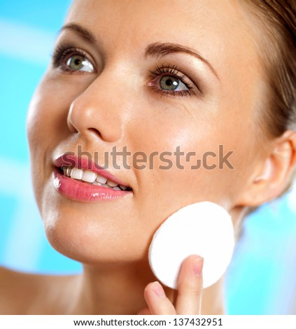 beautiful woman cares for the skin - stock photo