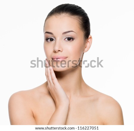 Beautiful woman cares for the skin face- posing at studio  isolated on white - stock photo