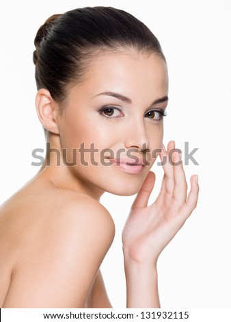 Beautiful woman cares for the skin face - posing at studio  isolated on white - stock photo