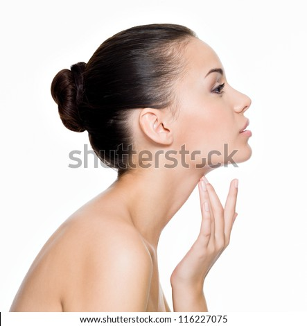 Beautiful woman cares for the skin neck- posing at studio  isolated on white - stock photo