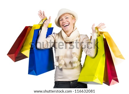 Beautiful woman carrying a lot of colorful shopping bags - stock photo