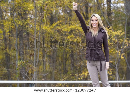 Beautiful woman cheering on her team in an outdoor environment