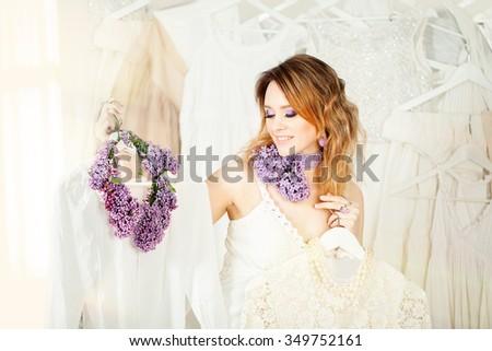 Beautiful Woman Chooses Fashion Summer Dress - stock photo