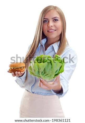 Beautiful woman choosing the healthy food and not the  junk food - stock photo