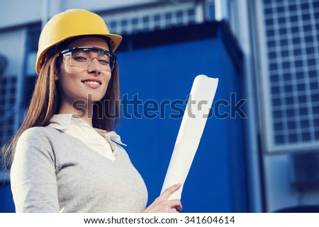 Beautiful Woman Civil Engineer Is Posing For Success In Front Of A Building  Civil Engineer