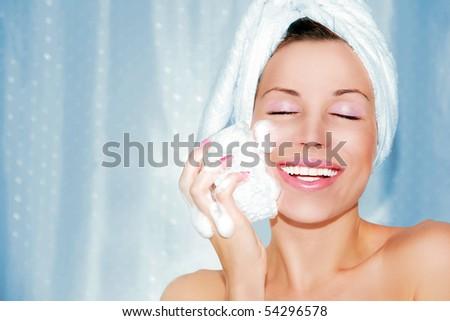 beautiful woman cleaning face. Beauty treatment - stock photo