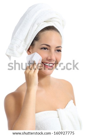 Beautiful woman cleaning her face with a baby wipe isolated on a white background