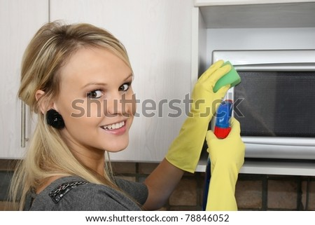 Beautiful Woman Cleaning Kitchen