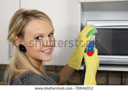 Beautiful Woman Cleaning Kitchen - stock photo