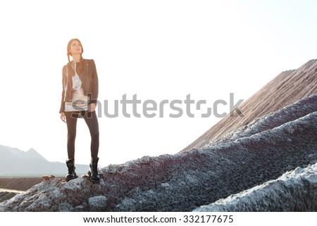 Beautiful Woman climbing into the mountains. Outdoors lifestyle portrait - stock photo