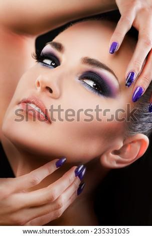 Beautiful woman close up on black background  - stock photo