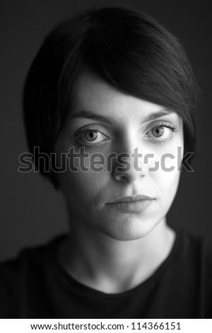 Beautiful woman close up portrait. Black and white image. - stock photo