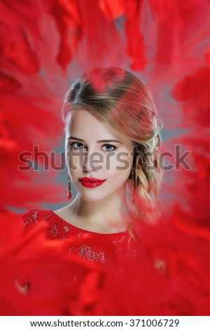 Beautiful woman closeup portrait with red lipstick and bohemian braids hairstyle framed in red