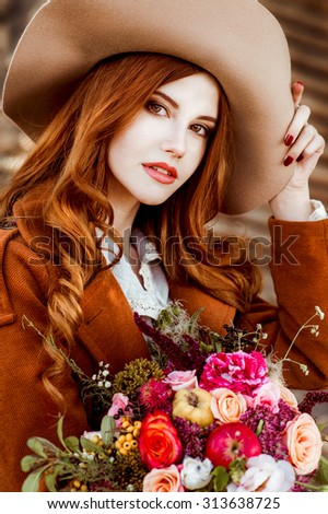 Beautiful woman clothing style boho in autumn outdoor. Woman in hat - stock photo