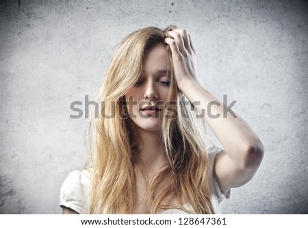 beautiful woman confused - stock photo