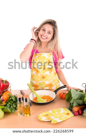 Beautiful woman cooking in the kitchen