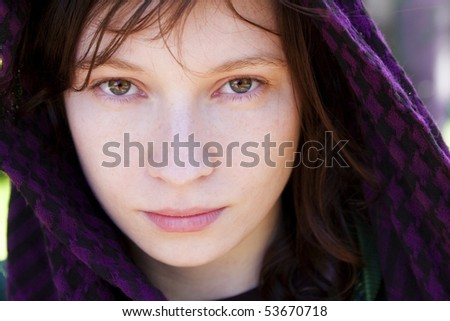 Beautiful woman covered by violet veil. - stock photo