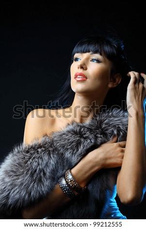 Beautiful woman covering the fur. Fashion art photo - stock photo