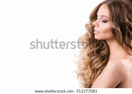 Beautiful Woman. Curly Long Hair. Isolated on white background. - stock photo