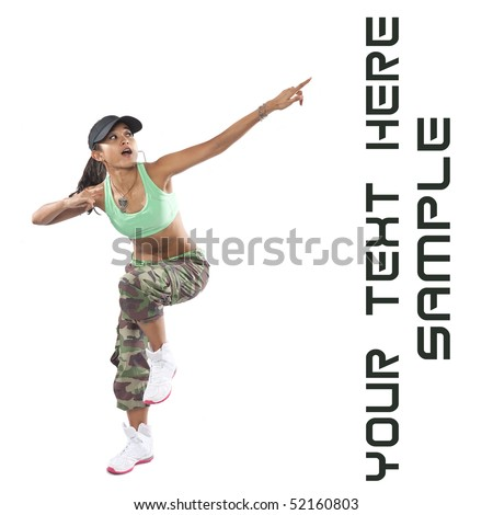 Beautiful woman dancer in hip hop attire striking a pose, pointing upwards. - stock photo