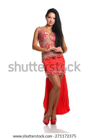 beautiful woman dancing in colorful Arabic dance costume.girl in an orange dress. beautiful brunette. long hair. - stock photo