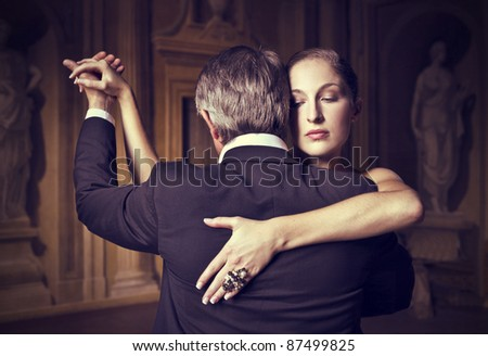 Beautiful woman dancing with a man - stock photo