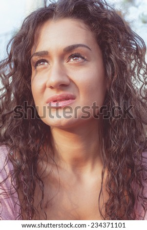 Beautiful woman daydreaming.  Close up of thoughtful young woman while looking up  - stock photo