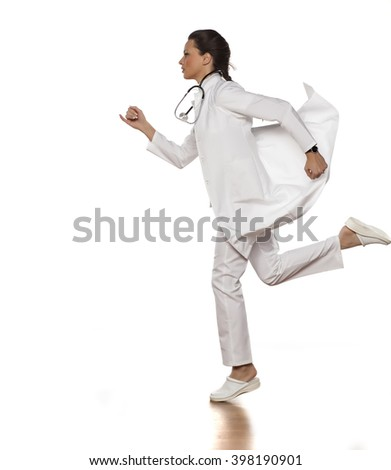 beautiful woman doctor in uniform running on white background