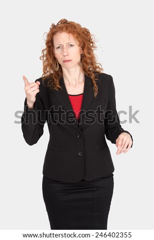 Beautiful woman doing different expressions in different sets of clothes: be careful - stock photo