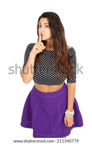 Beautiful woman doing different expressions in different sets of clothes: be quiet - stock photo