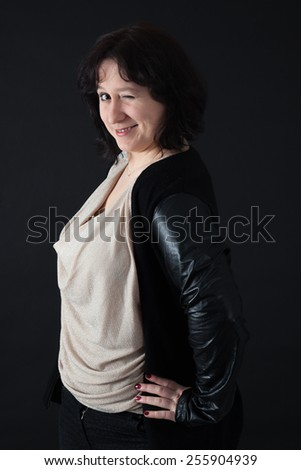 Beautiful woman doing different expressions in different sets of clothes: blinking - stock photo