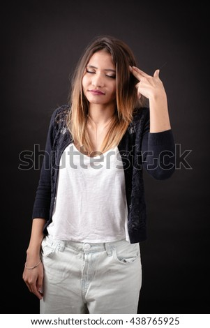 Beautiful woman doing different expressions in different sets of clothes: commit suicide - stock photo