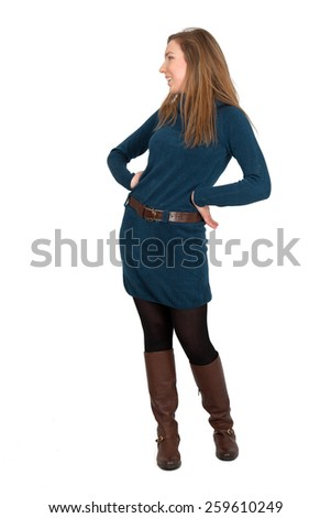 Beautiful woman doing different expressions in different sets of clothes: full length hands on hips