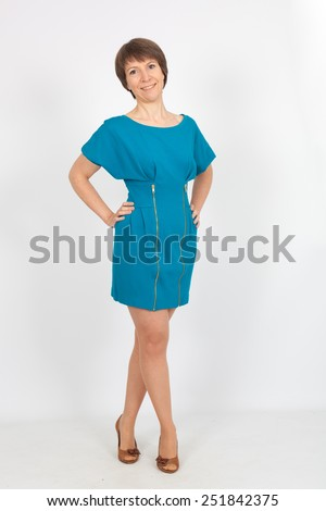 Beautiful woman doing different expressions in different sets of clothes: full length posing - stock photo