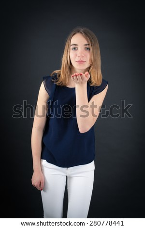 Beautiful woman doing different expressions in different sets of clothes: kiss - stock photo
