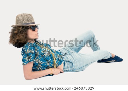 Beautiful woman doing different expressions in different sets of clothes: posing with hat and sunglasses - stock photo