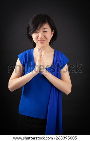 Beautiful woman doing different expressions in different sets of clothes: prayer