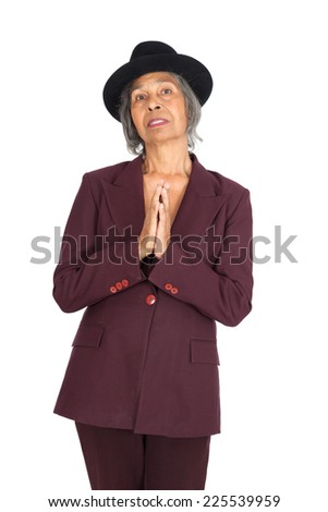 Beautiful woman doing different expressions in different sets of clothes: praying - stock photo