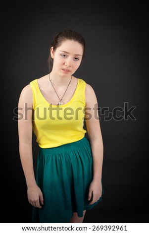beautiful woman doing different expressions in different sets of clothes: tired - stock photo