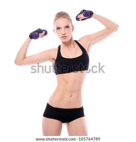 Beautiful woman doing exercises with dumbells over white background