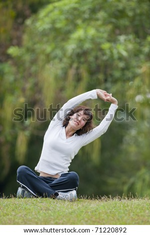 Beautiful Woman doing Fitness and Yoga - stock photo