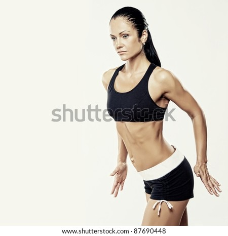 Beautiful woman doing fitness exercise. - stock photo